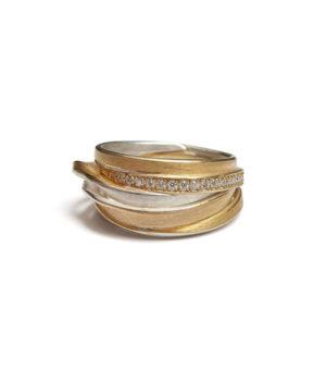 Ute Strothotte, Ring «Gewickelt WR122», 925/- Silber, 900/- Gelbgold, Brillanten